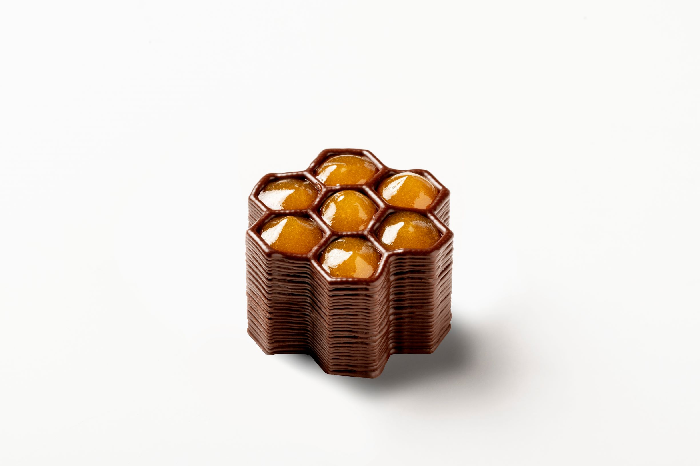 3D printed chocolate shape filled with marmalade made by a FoodJet 3D printing system