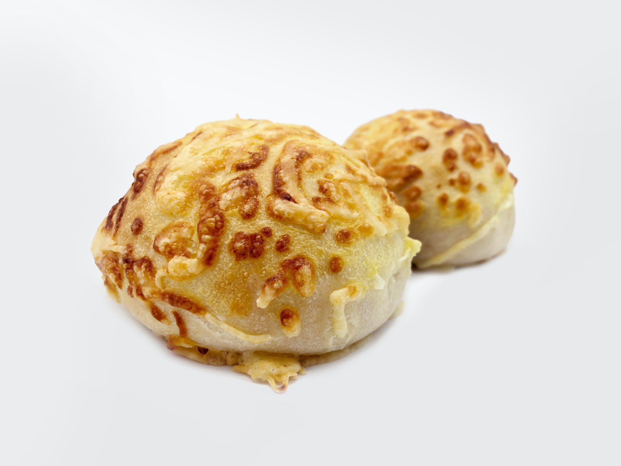 Two buns covered with cheese made with FoodJet food depositor