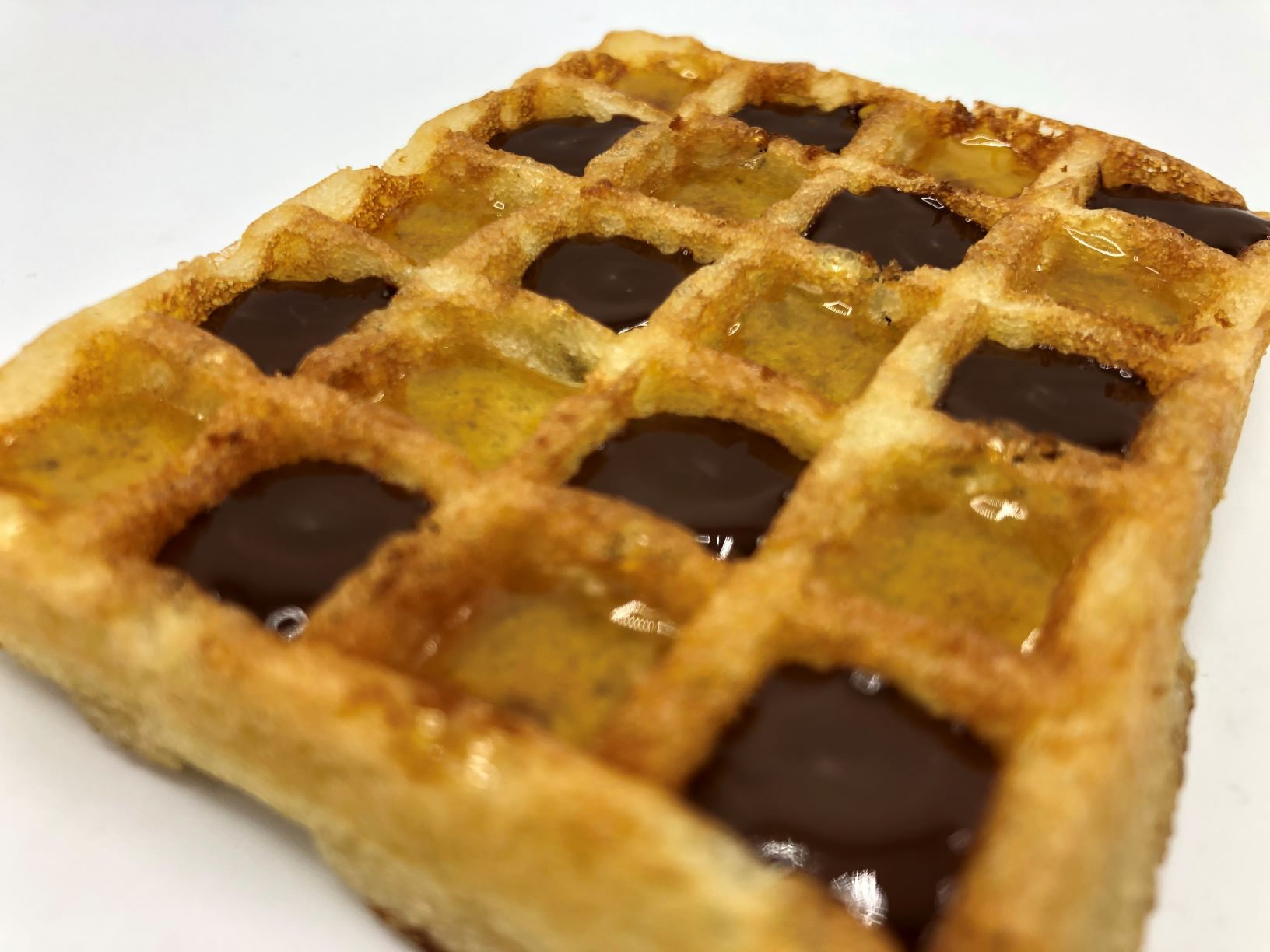 Egg waffle filled with marmalade and chocolade by FoodJet chocolate depositor