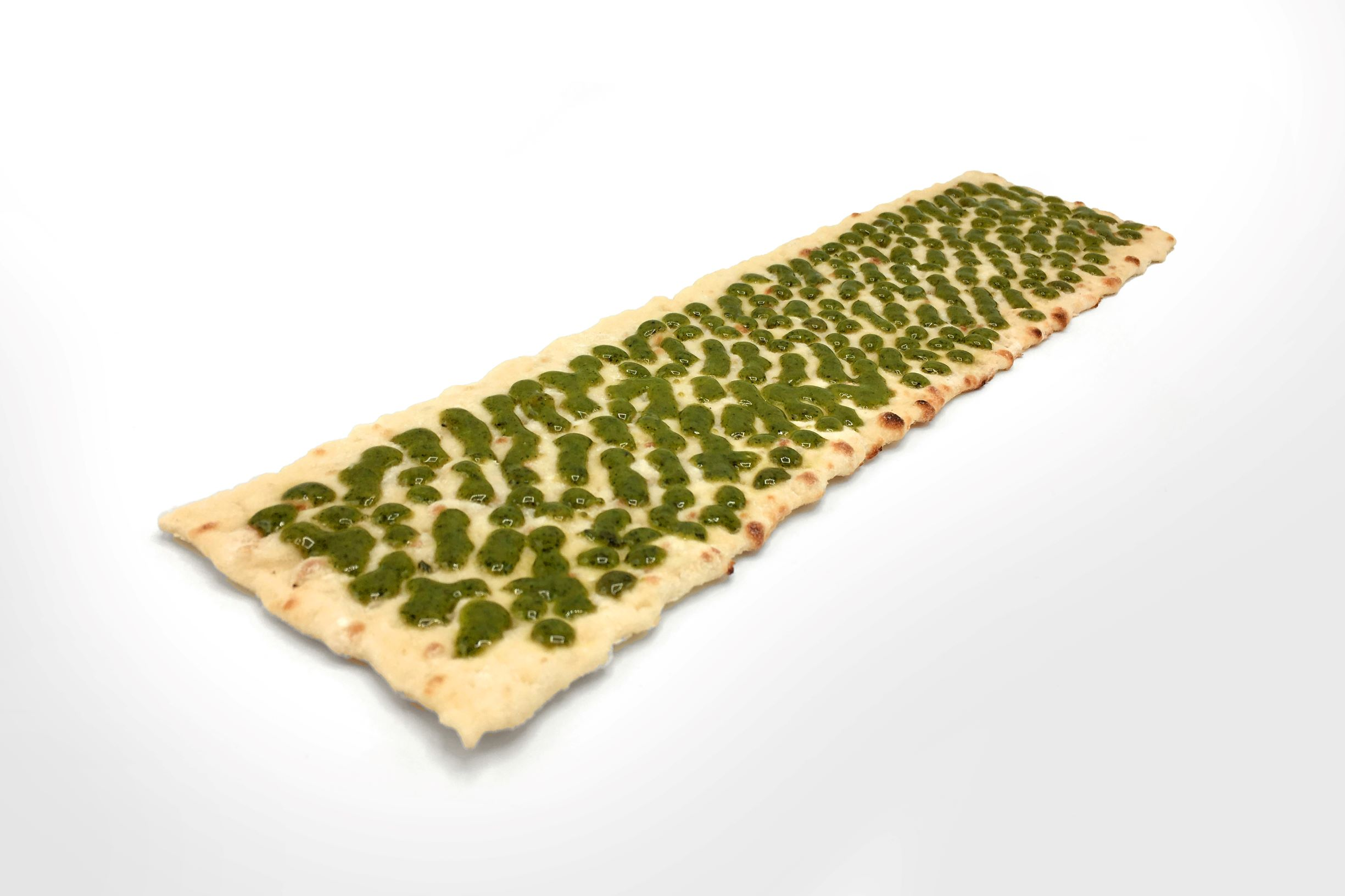 Flatbread with pesto sauce evenly applied by FoodJet sauce depositor.jpg