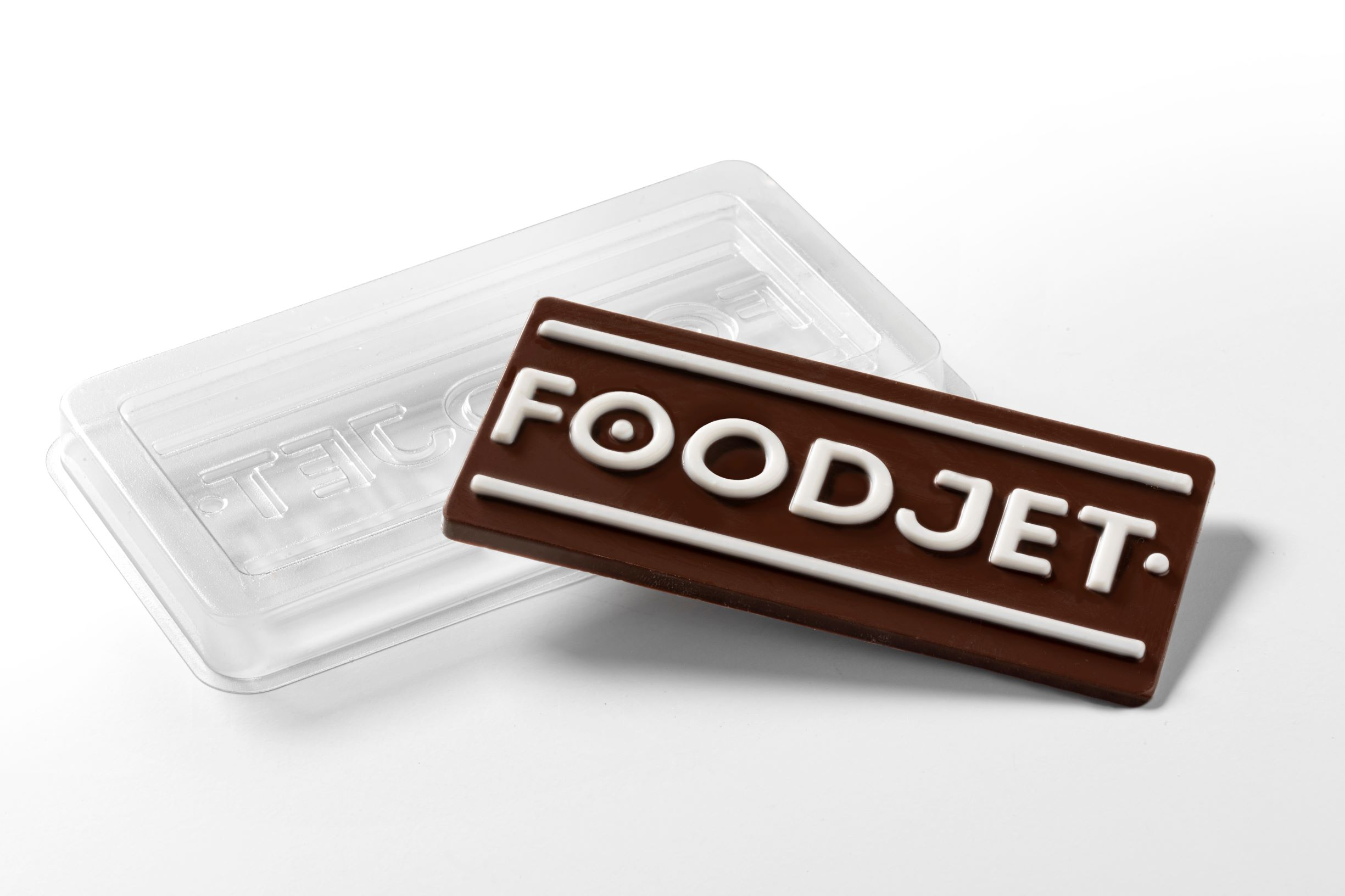 Milk chocolate bar with white cavity filled chocolate print by FoodJet chocolate depositor