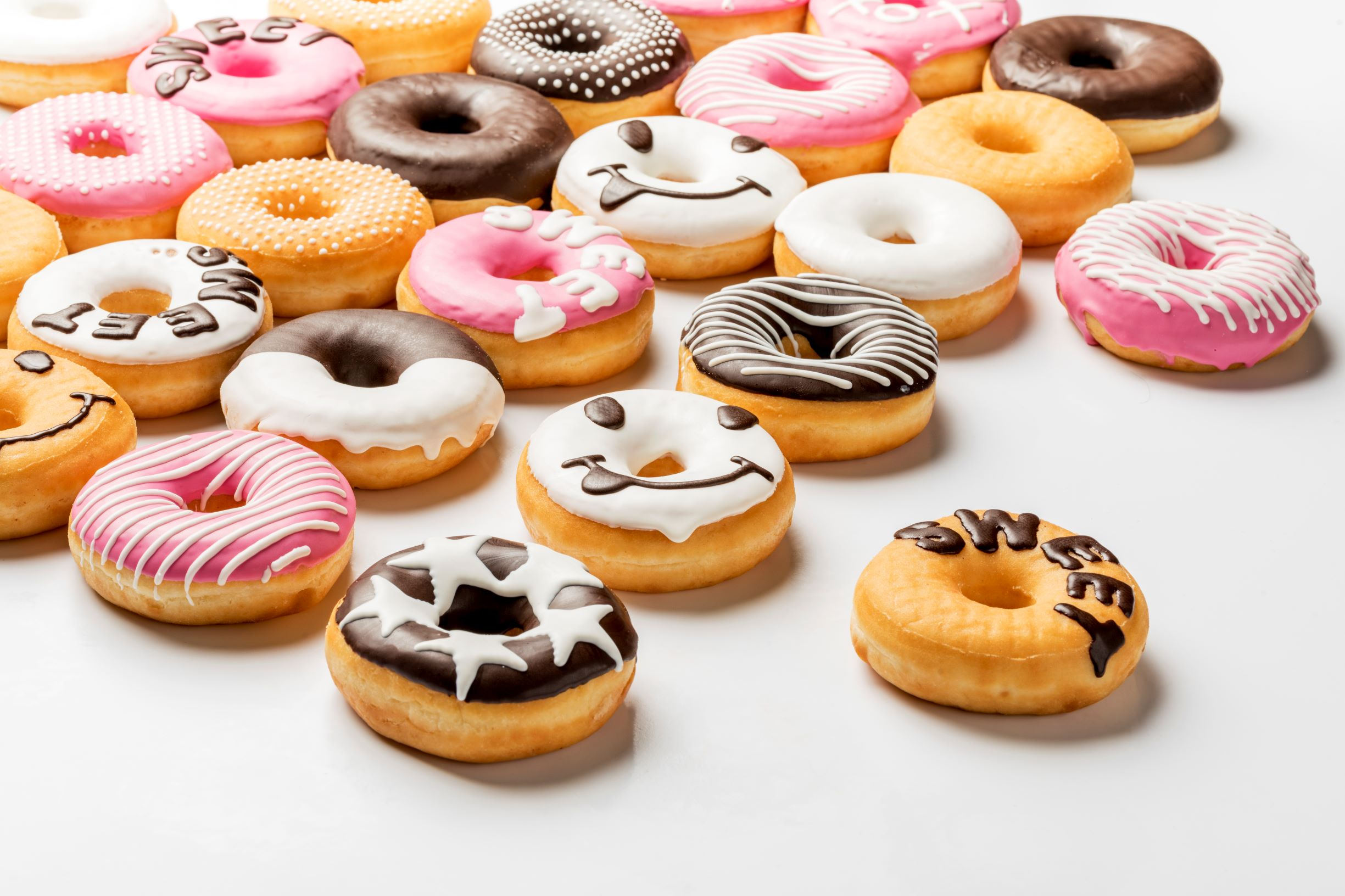 Wide range of chocolate decorated donuts made with FoodJet chocolate depositor