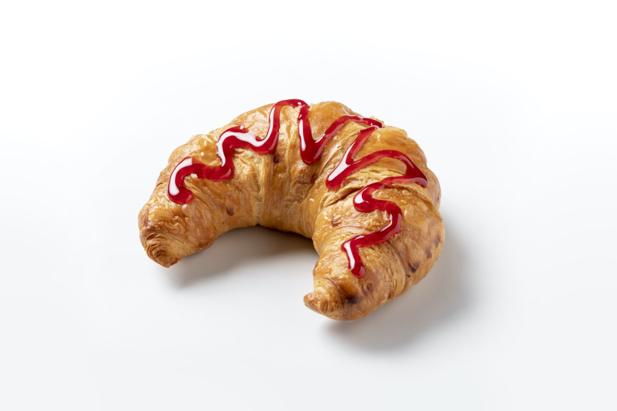 Croissant with a decoration of marmalade deposited by a FoodJet precision depositor
