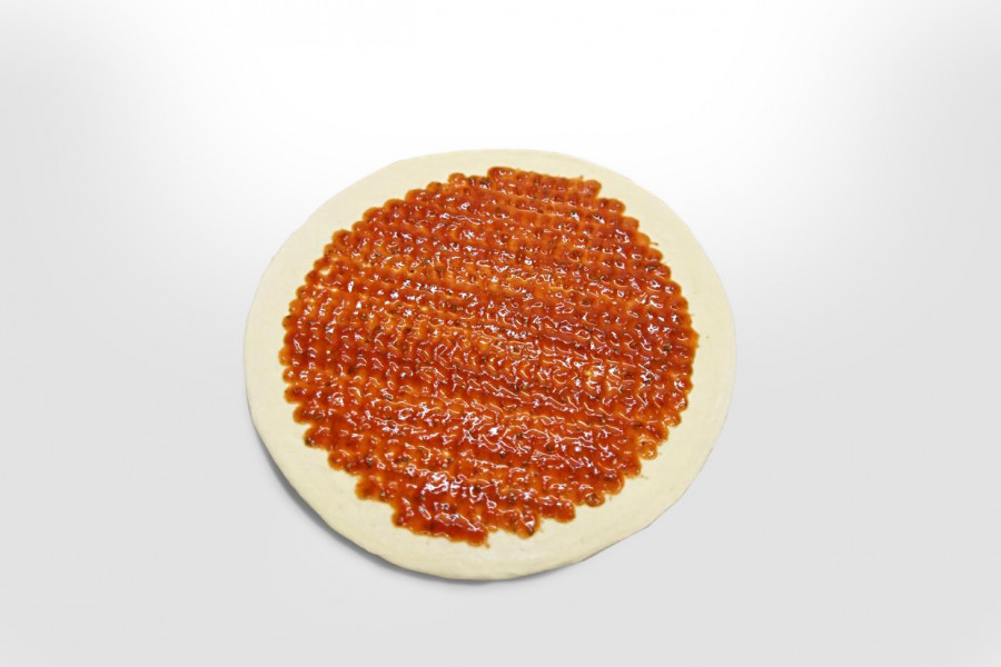 Pizza surface covered with tomato sauce by a FoodJet pizza sauce depositor