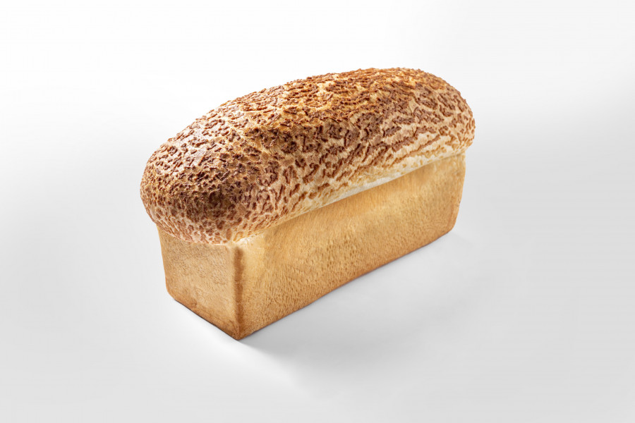 Loaf of bread covered with tiger wash by a FoodJet tiger paste depositor