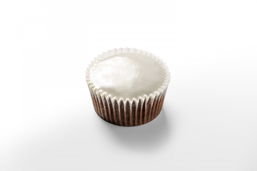 Brown cupcake covered with white chocolate by a FoodJet precision depositing system